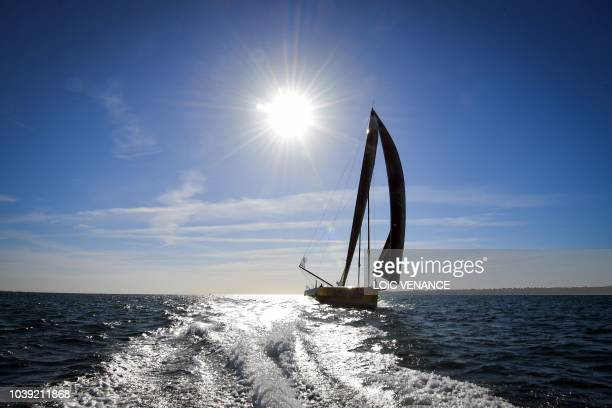 French sailor Louis Burton sails his Imoca 60 monohull Bureau Vallee, from Lorient to Saint-Malo, on September 24 a few weeks prior to the start of...