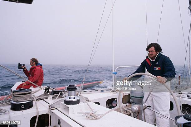 French sailor Olivier de Kersauson and crewman Gerard Djikstra attempt the FrancoBritish Double Transat abord the trimaran Jacques Ribourel which...