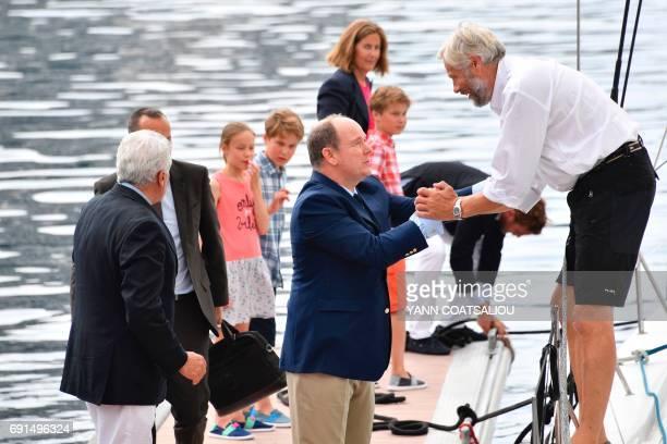 French sailor Yvan Griboval is welcomed by Prince Albert II of Monaco flanked by Monaco Yacht Club President Bernard d'Alessandri Oceano Scientific...