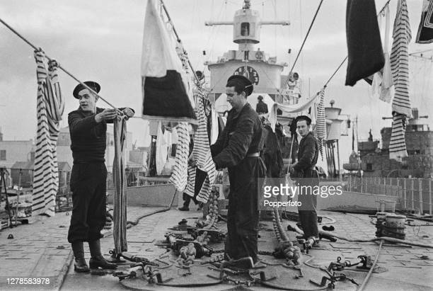 French sailors of the Free French Naval Forces hang out their washing, including mariniere or Breton striped shirts, aboard the French destroyer Le...