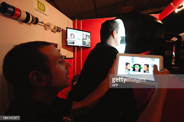 French Sales and Marketing director of Digiteyezer Didier Cholet poses for a 3D scan of his face in a 3D photobooth before 3D printing with the...