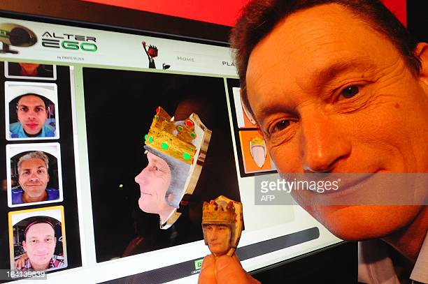 French Sales and Marketing director of Digiteyezer Didier Cholet shows his avatar made with the Alterego device from a scan of his face after 3D...