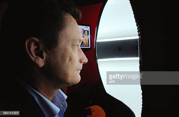 French Sales and Marketing director of Digiteyezer Didier Cholet is pictured in a 3D photobooth that scans and prints in 3D human face with the...