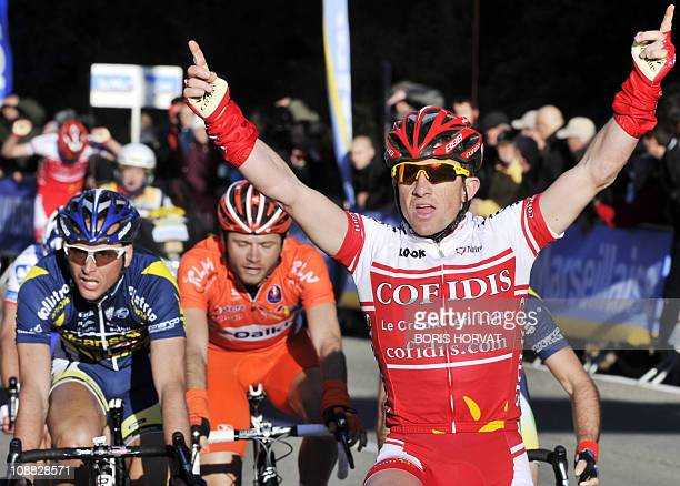 French Samuel Dumoulin raises his arms in victory as he crosses the finish line of the Etoile of Besseges cycling race third stage on February 4 2011...