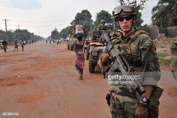 French Sangaris soldiers patrol in Bangui on February 8 2014 France's 1600 troops and the African Union's contingent of more than 5000 have so far...