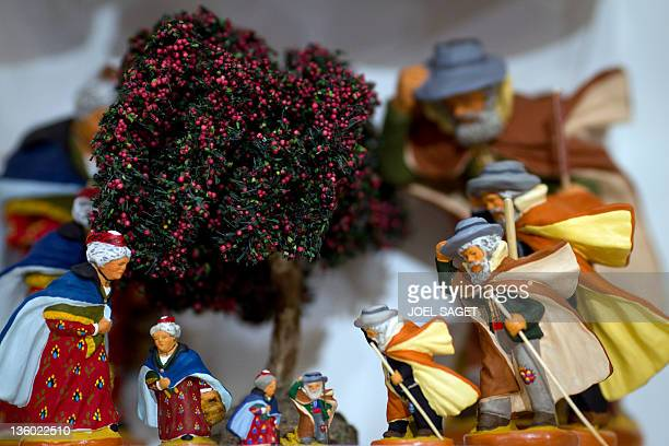 French 'Santons de Provence' Christmas figurines for cribs are displayed for sale in a department store in Paris on December 16 one week ahead of...