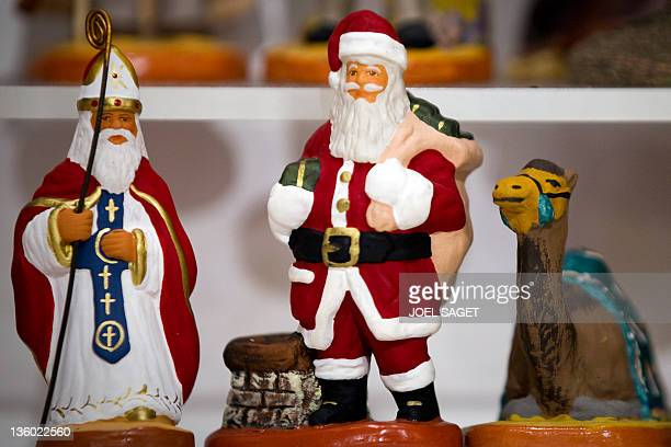 French 'Santons de Provence' Santa Claus figurines are displayed for sale in a department store in Paris on December 16 one week ahead of Christmas...