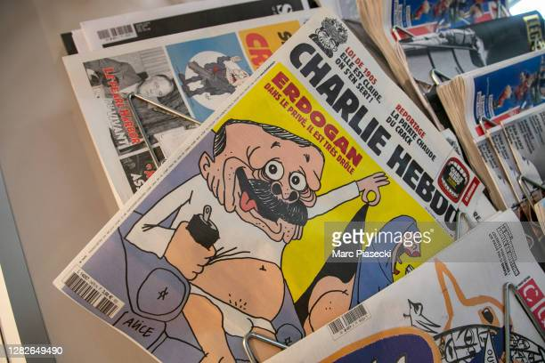 French satirical weekly Charlie Hebdo's edition displaying a cover with a satirical drawing representing Turkish President Tayyip Erdogan is...