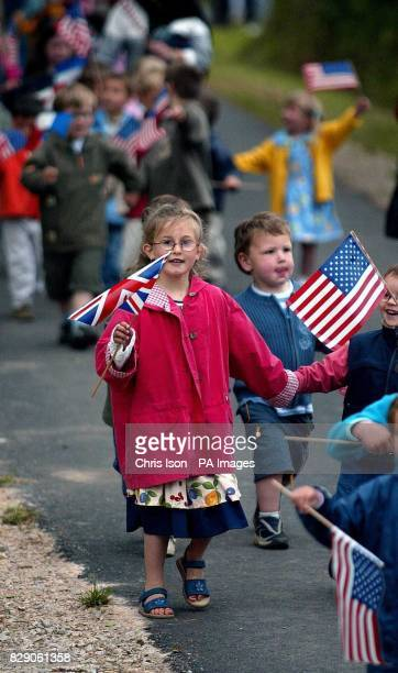 French school children from Magneville in Normandy wave British and American flags at a memorial in their village today to soldiers of the 101st...