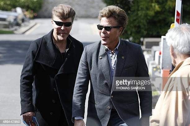 French scientific journalists Igor and Grichka Bogdanoff arrive for the funeral ceremony for late French singer Guy Beart on September 21 2015 in...