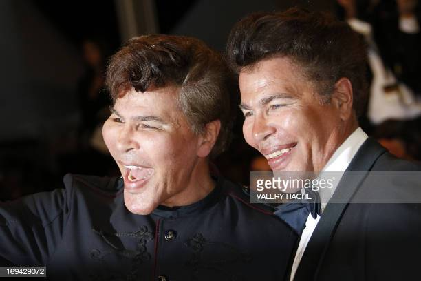 French scientific journalists Igor et Grichka Bogdanoff pose on May 24 2013 as they arrive for the screening of the film Michael Kohlhaas presented...