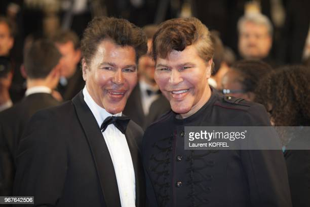 French scientific journalists Igor et Grichka Bogdanoff pose on May 24, 2013 as they arrive for the screening of the film 'Michael Kohlhaas'...