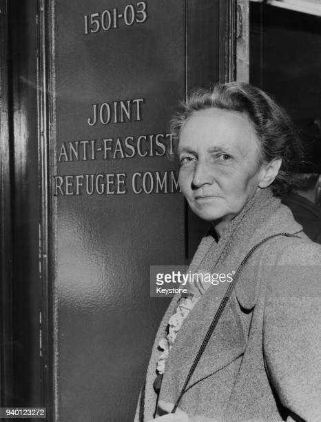 French scientist Irène JoliotCurie enters the office of the Joint AntiFascist Refugee Committee in New York after being detained overnight by...