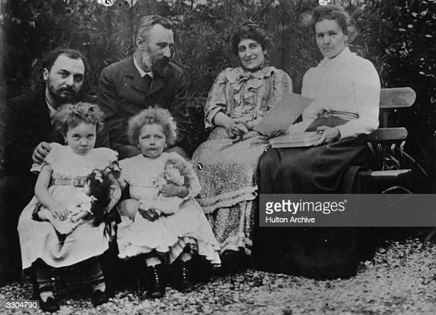 French scientists and Nobel Laureates Marie Curie on right and husband Pierre Curie second from left with their friends the Perrins