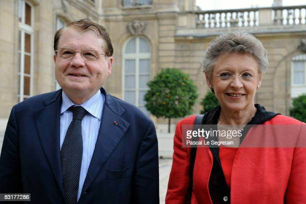 French scientists Francoise Barre-Sinoussi and Luc Montagnier are seen in the courtyard of the Elysee Palace after a meeting with French President...