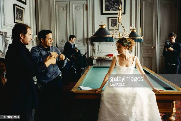 French screenwriter and actor Christopher Thompson director Thierry Klifa and actress Anouk Grinberg on the set of Klifa's film Une Vie a T'Attendre