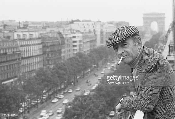 French screenwriter and director Michel Audiard looks over the ChampsElsees from the balcony of his production office in Paris Born in Paris in 1920...