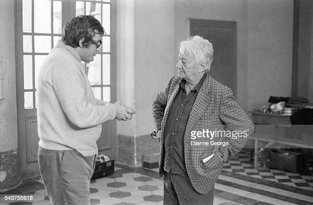 French screenwriter Jean Aurenche and French director Bertrand Tavernier on the set of Tavernier's film Le Juge et l'Assassin Jean Aurenche and...