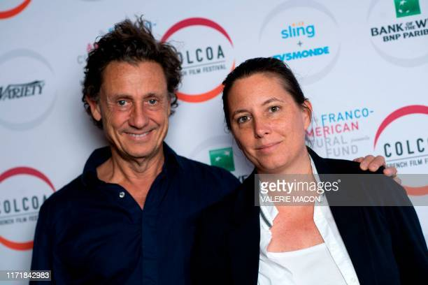French screewriter/director Gilles de Maistre poses with COLCOA Deputy Director Anouchka Van Riel during the French Film Festival City of Light City...