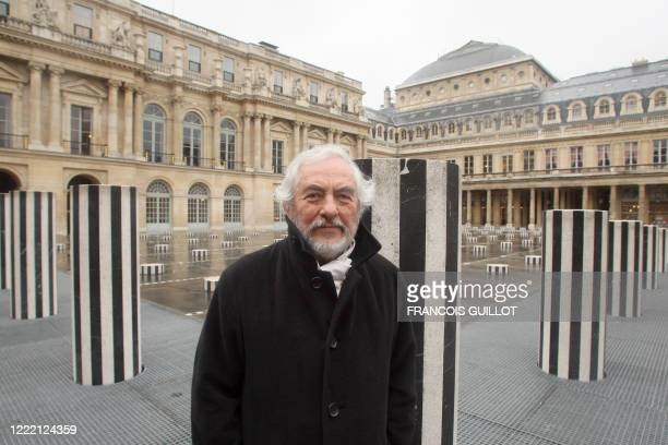 French sculptor Daniel Buren poses in front of his halfdestroyed columns 15 January 2008 next to the historic stateowned PalaisRoyal garden near the...