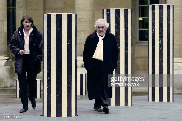 French sculptor Daniel Buren walks past his halfdestroyed columns with French Culture Minister Christine Albanel after talks focused on the...
