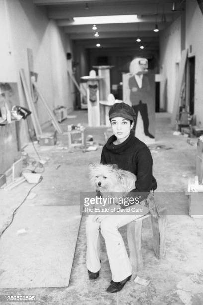 French sculptor of Venezualan heritage Marisol Escobar poses for a portrait in their studio on January 30, 1967 in New York City, New York. Marisol's...