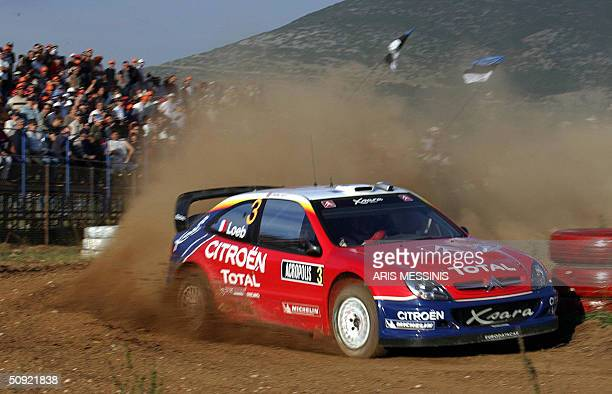 French Sebastian Loeb and his codriver Daniel Elena with their Citroen Xsara compete during the Acropolis rally of Greece in the Lilea special stage...