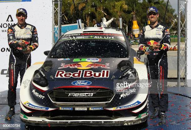 TOPSHOT French Sebastian Ogier and codriver Julien Ingrassia celebrate their victory after winning the 2018 FIA World Rally Champions in Leon...