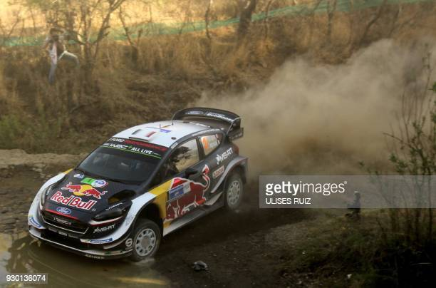 French Sebastian Ogier and codriver Julien Ingrassia steer their Ford Fiesta WRC during the second day of the 2018 FIA World Rally Championship in...