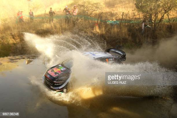 TOPSHOT French Sebastian Ogier and codriver Julien Ingrassia steer their Ford Fiesta WRC during the second day of the 2018 FIA World Rally...