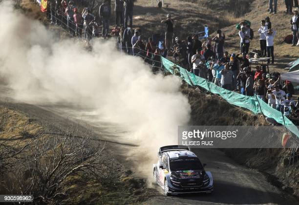 French Sebastian Ogier and codriver Julien Ingrassia steer their Ford Fiesta WRC during the final day of the 2018 FIA World Rally Championship in...
