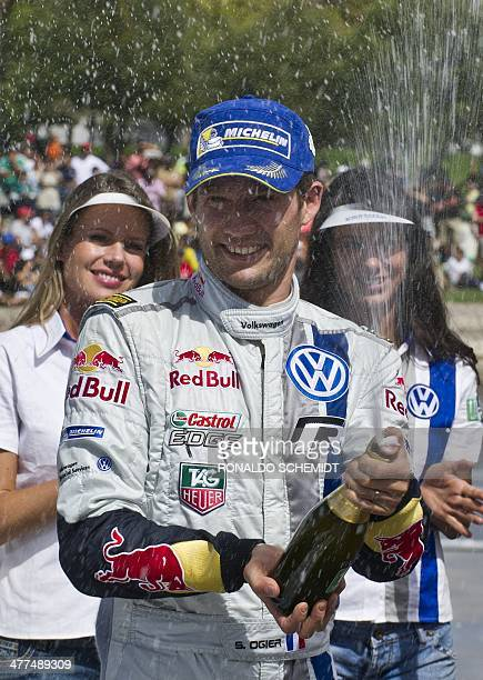 French Sebastian Ogier celebrates his victory in the 2014 FIA World Rally Championship in Leon Guanajuato state Mexico on March 9 2014 AFP...