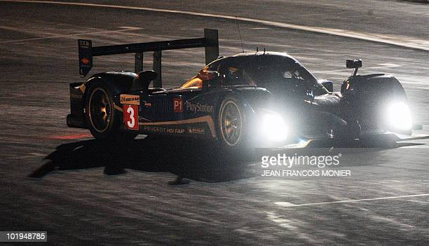 French Sebastien Bourdais steers his Peugeot 908 HdiFAP N°3 on his way to clock the best time in 3' 19711 on June 9 2010 in Le Mans western France...