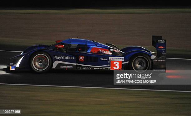 French Sebastien Bourdais steers his Peugeot 908 HdiFAP N°3 on June 9 2010 in Le Mans western France during the first free practice session of the Le...
