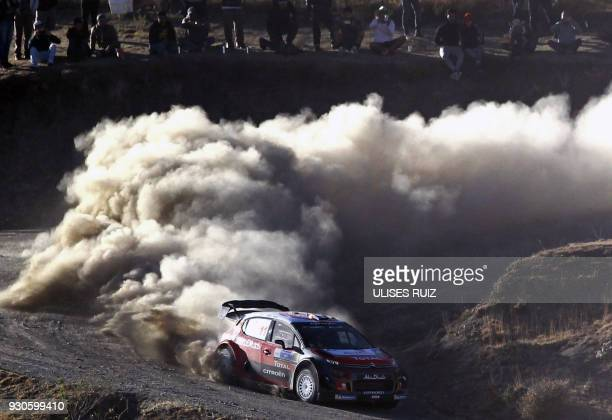 TOPSHOT French Sebastien Loeb and codriver monegasque Daniel Elena steer their Citroen C3 during the final day of the 2018 FIA World Rally...