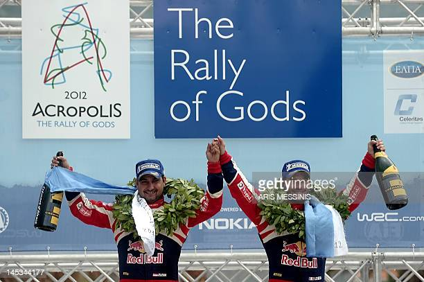 French Sebastien Loeb and his codriver Daniel Elena celebrate after their victory at the WRC Acropolis rally in Loutraki on May 27 2012 Teammate...