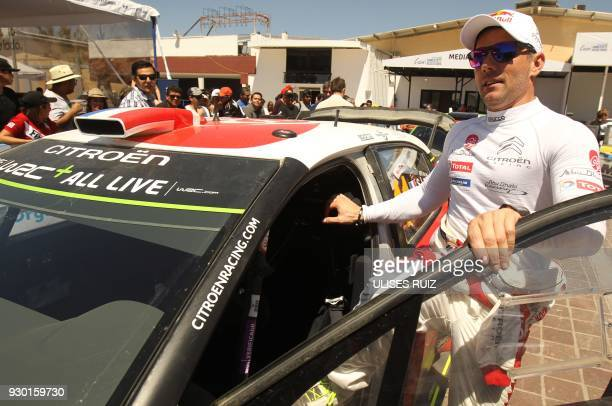 French Sebastien Loeb arrives with his Citroen C3 to sign autographs to fans during a break in the second day of the 2018 FIA World Rally...