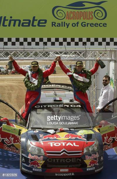 French Sebastien Loeb with Monaco's Daniel Elena celebrate on their Citroen C4 after winning the 55th Acropolis Rally in Greece as part of the World...