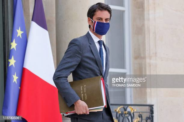 French Secretary of State and Government's spokesperson Gabriel Attal looks on as he leaves after taking part in the weekly cabinet meeting at The...