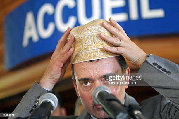 French Secretary of State for Overseas Territories Yves Jego adjusts a local hat before speaking upon his arrival at the General council in...