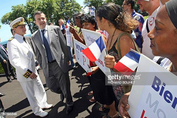 French Secretary of State for Overseas Territories Yves Jego is greeted by inhabitants upon his arrival in SaintDenis de la Reunion on March 27...