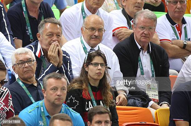 French Secretary of State for Sports Thierry Braillard and Bernard Lapasset attend the Women's semifinal handball match between France and The...
