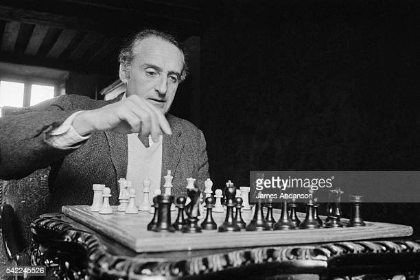 French Secretary of State of Agriculture and author Jean-Francois Deniau playing chess at home near Blois.