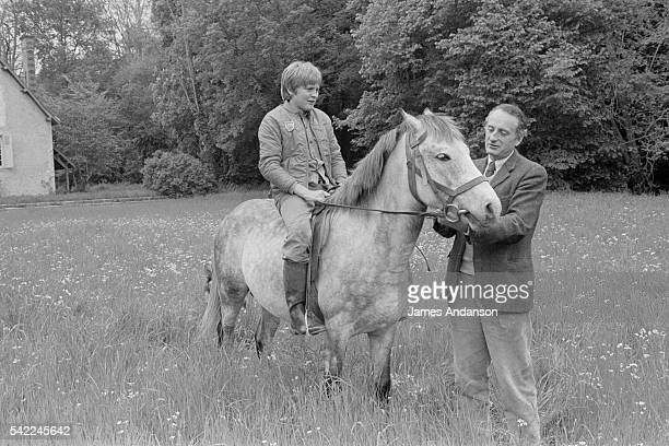 French Secretary of State of Agriculture and author JeanFrancois Deniau with his son Gregoire and horses at home near Blois