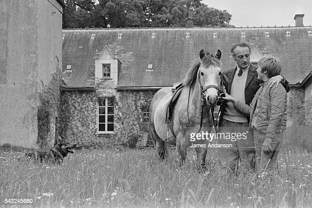 French Secretary of State of Agriculture and author Jean-Francois Deniau with his son Gregoire and horses at home near Blois.