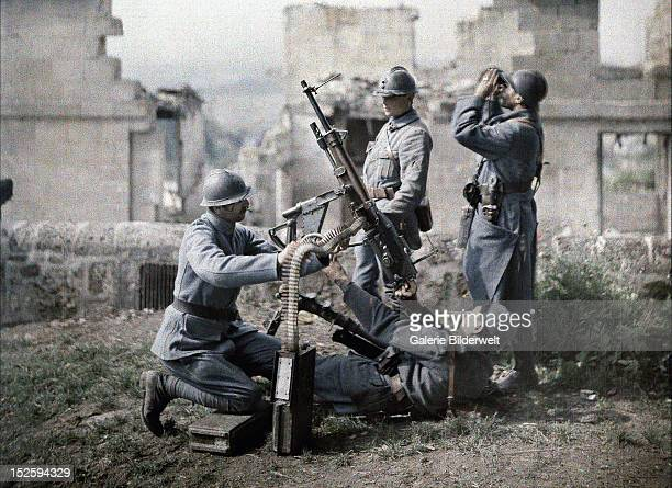 A French section of machine gunners has taken position in the ruins during the battle of the Aisne Western Front World War I 1917 Color photo by...