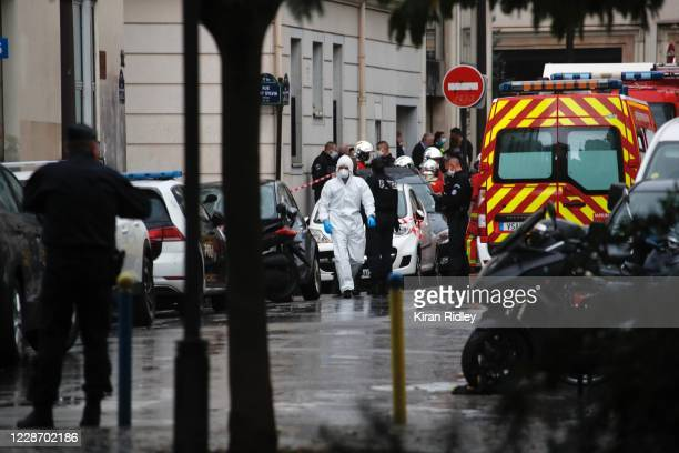 French security and medical workers on site after an incident in front of the former Charlie Hebdo headquarters and scene of a terrorist attack in...