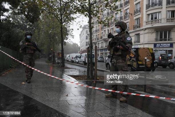 French security forces secure the area of crime after an incident in front of the former Charlie Hebdo headquarters and scene of a terrorist attack...
