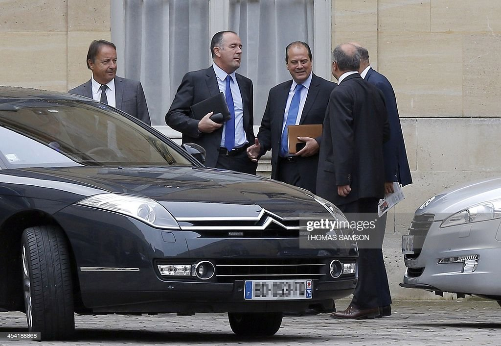 French Senate President Jean-Pierre Bel, Socialist group president for the Senate Didier Guillaume, French Socialist Party (PS) first national secretary Jean-Christophe Cambadelis, leave the Hotel Matignon in Paris after a meeting, on August 26, 2014. France's prime minister was set to appoint a new cabinet on August 26 after tendering his government's resignation amid a row over economic policy, plunging the country into a fresh political crisis.