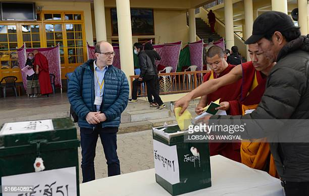French Senator Andre Gattolin looks on as exiled Tibetans cast their votes to elect a Sikyong of the Central Tibetan Administration and members of...